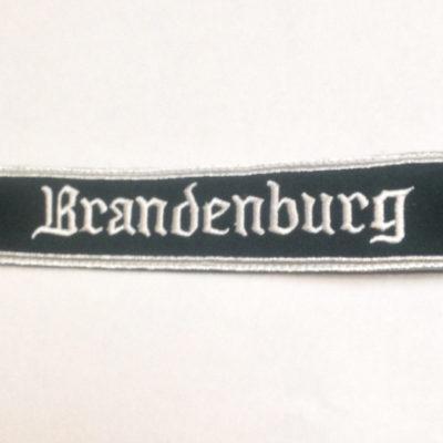 German Army BRANDENBURG cuff title on dark Green wool